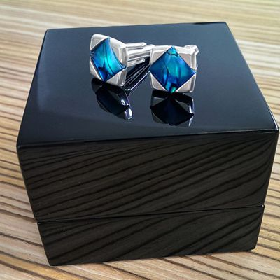 Blue cufflinks in luxury packaging